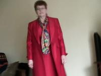 White granny in red coat masturbates on home video