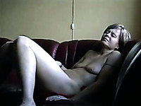 Horn-mad mature wifey of my buddy fingers herself on the sofa