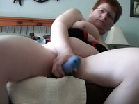 Mature short haired white lady in solo masturbation action