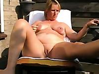 Slutty light haired amateur wifey of my neighbor masturbates on veranda