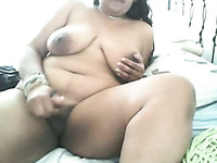 Chubby ugly amateur Indian fatso with huge boobs masturbates her twat
