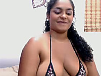 Chubby curly haired amateur nympho flashes her big boobies
