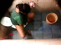 Hidden cam in the toilet room catches Indian milf wife