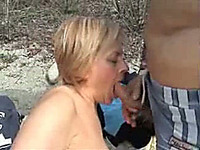 Lewd mature blonde wife gives me blowjob at the rocky beach