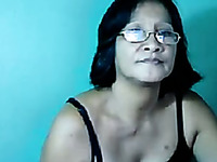 Short haired mature Asian lady in glasses stripteased for me on webcam