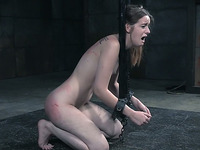Cute white young chick handcuffed nude to the pipes