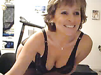 Short auburn haired MILF in black lingerie flashed me her nice boobs