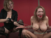 Busty white blonde milf bound and caned nude by dominant mistress