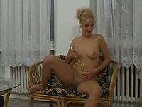Adorable white blonde cutie undresses and masturbates with a dildo