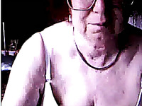 Ugly four eyed granny from Germany exposes her time worn cunt on webcam