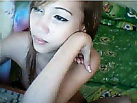 Captivating Asian webcam chick chats with me topless