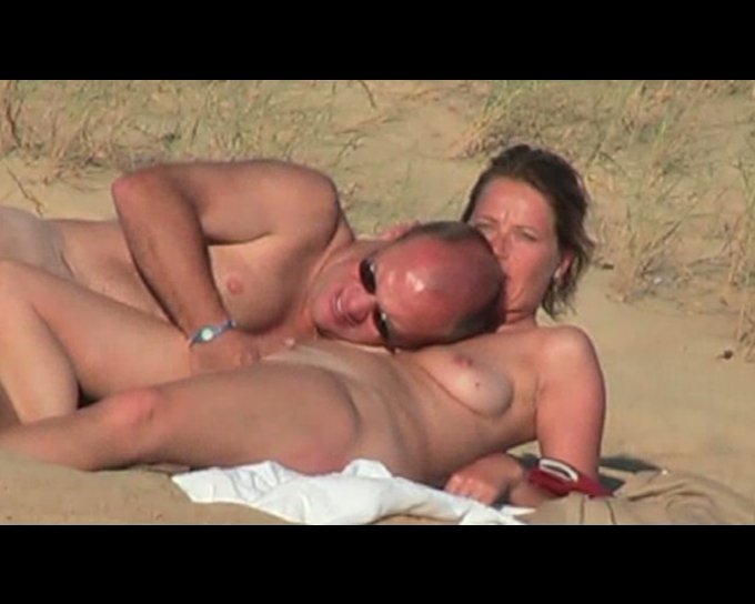 on beach nude having Couple sex