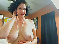 Mature mom with juicy jugs and sexy ass shows me her goodies on webcam
