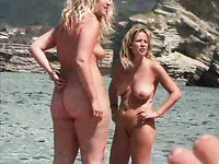 Peeking on two thick blonde moms walking on the nude beach naked