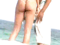 Tanned girlfriend with big butt teases my friend on the beach
