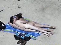 Sexy girlfriend on the beach gives handjob to her partner
