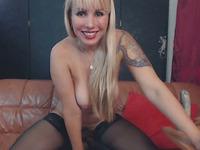 Blonde Tattooed Milf In Stockings Masturbates