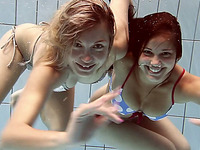 Two gorgeous amateur Russian cuties swimming underwater