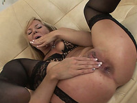 Naughty and hot blonde milf on the couch toys herself hard