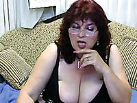 Red-haired webcam model is proudly flaunting her big luscious boobs