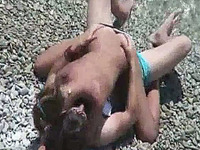 Horny girlfriend topless on the beach wants to ride her man