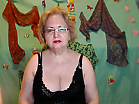 Sexy blonde granny in black lingerie shows me her saggy boobs