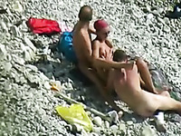 Sexy chick and two horny dudes enjoy foreplay on the beach when I spy them