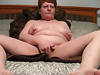 My nasty mature wife masturbates with fingers and big vibrator