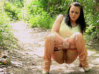 Hot brunette babe in sexy pants pees in the forest