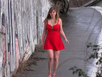Sexy babe in red hot dress finds a place to urinate