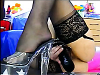 Voluptuous blonde MILF in nylon stockings playing with her pussy on webcam