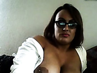 Short haired MILF in glasses showed off her perfect big boobies