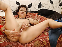 Nice and quite wild mature brunette whore was masturbating her vagina