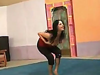 Raven haired Indian wife does her yoga exercises tight yoga pants