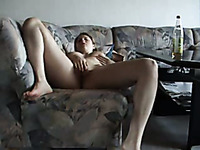 Kinky ex-GF of mine undressed and masturbated her own cunt on sofa