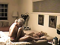Mature couple was taped on cam while fucking missionary style on wide bed