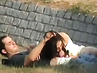 Spying on horny couple having sex on a lawn outdoor