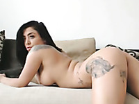Zealous tattooed curvy brunette cam babe was rubbing her bald pussy