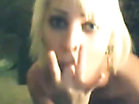 Blonde cutie fingering wet pussy sensually in front of camera