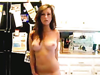 Brunette sweetheart stripping seductively in front of camera