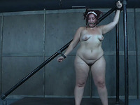 BBW redhead bimbo gagged and whipped hard in the BDSM basement