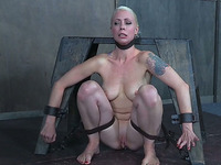 Short haired elegant blonde milf restrained to the Spanish ride