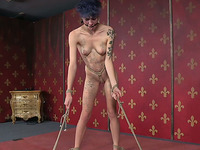 Short haired brunette inked girl bound and stretched