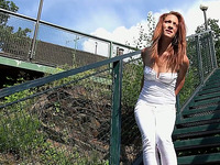 Cute redhead sporty babe pulls down her white pants and pees