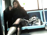 Voyeur video from public bus - brunette chick in black pantyhose