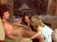 Two hot white chicks sharing one dick on the armchair
