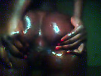 Dark skinned babe stretches her oiled up butt cheeks exposing her pussy to me on webcam