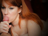 Sensational and busty redhead cutie giving incredible blowjob
