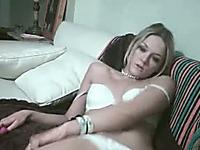 Skanky blonde bitch with skinny body playing with a dildo
