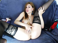 Chestnut haired pallid but eye catching cam nympho was fingering herself